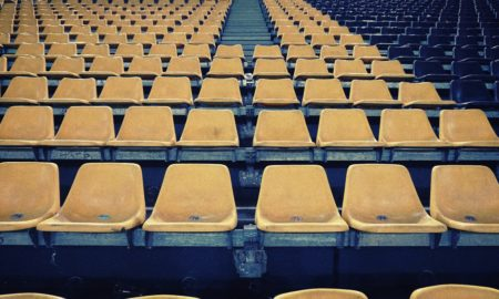 yellow chairs in football stadium